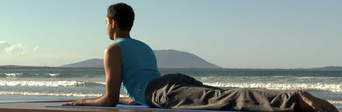 Dru Yoga healthy back sphinx posture, beach