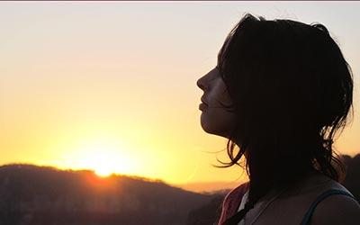 Woman admiring a beautiful sunset